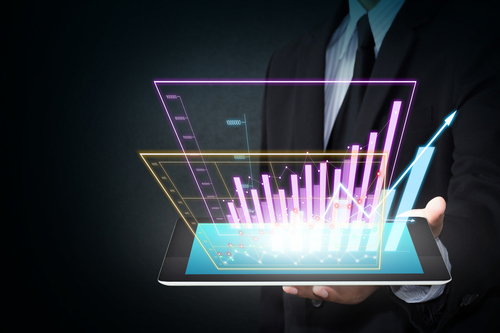 A partial image of a man holding an IPad with a holographic salary chart emanating from it