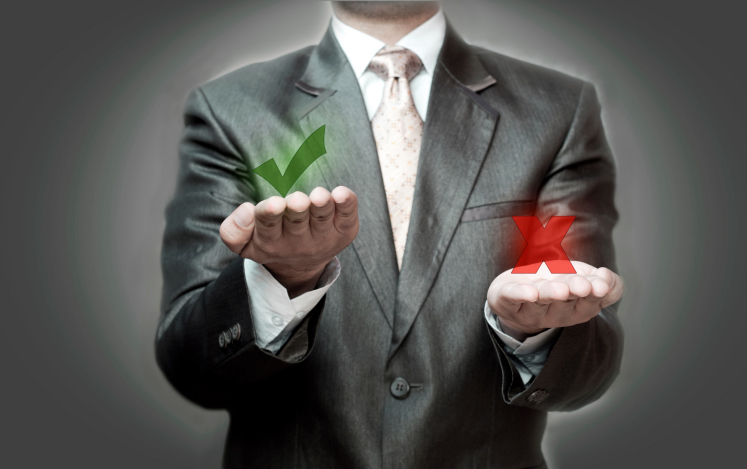 A businessman with hands extended holds a green checkmark and a red X