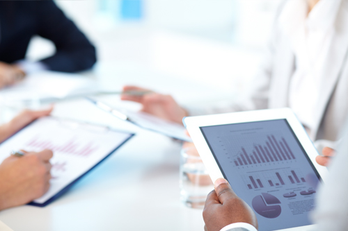 Accountants study the numbers at a conference table