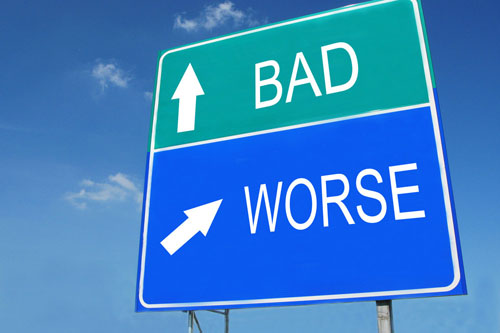 A road sign shows: Bad, ahead and: Worse, off to the right