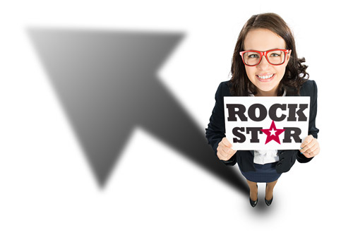 A female administrative assistant holds a sign that reads, Rock Star
