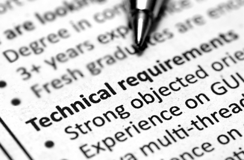 """A pen lying on an accountant's job description points to """"Technical requirements"""""""