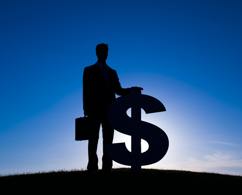 An accountant and a dollar sign are silhouetted on a blue sky