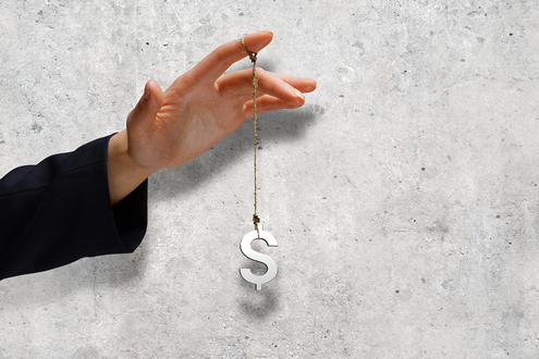 A dollar sign dangles from a job candidate's hand