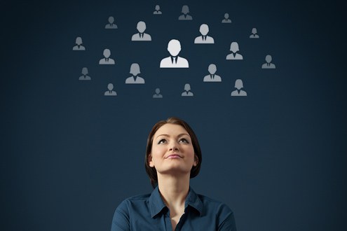 A candidate is looking up at figure symbols of recruiters