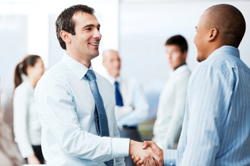 Two men shaking hands at a consultant networking event
