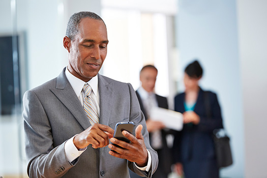 A professional uses his smartphone to view consulting opportunities