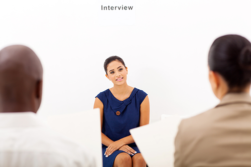 A female applicant is being interviewed for an executive assistant job