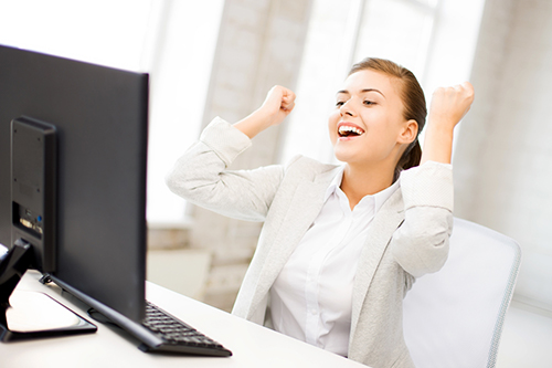 A candidate raises her fists as she reads an email saying shes gotten a receptionist job