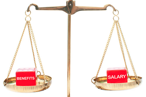 Scales of justice weigh salary vs. benefits