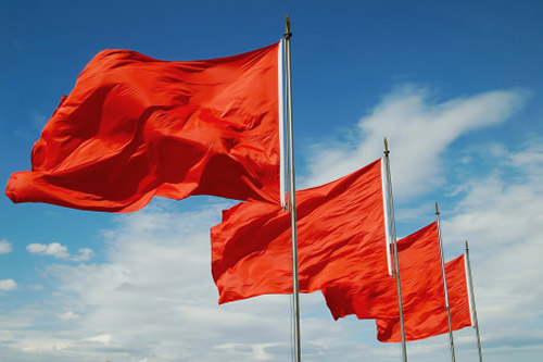 Four red flags blow in the wind
