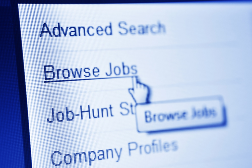 """A computer cursor glove selects the """"Browse Jobs"""" tab on a website"""