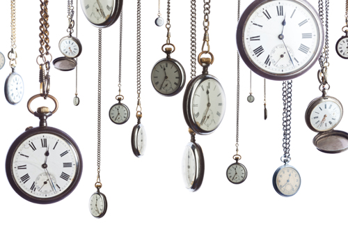Multiple pocket watches are hanging