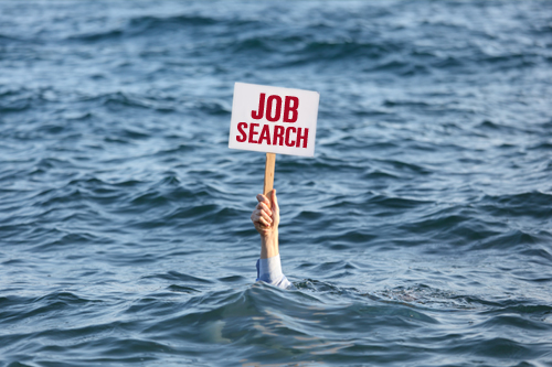 "An arm is emerging from an ocean and holds a sign that says ""Job Search"""