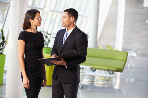 A recruiter discusses hiring a commercial litigation attorney with a client