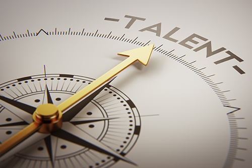 A compass is pointing to the word Talent