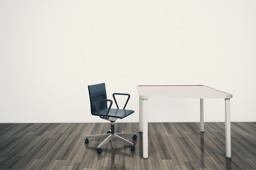 An empty chair and desk