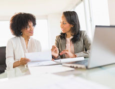 A technology staffing services recruiter meets with a client
