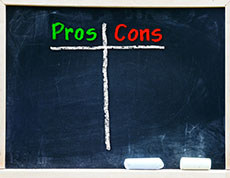 A chalkboard with columns for listing the pros and cons of using an information technology staffing agency