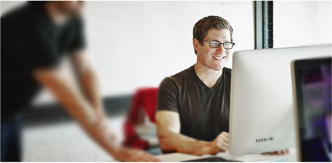 An information technology professional works at a computer