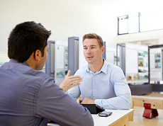 A recruitment agency professional discusses options with a prospect