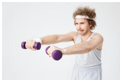 How to Talk About Your Weaknesses in a Job Interview — image of weak man struggling to lift weights