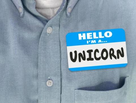 "Name tag sticker on a man's shirt reads, ""Hello, I'm a Unicorn"""