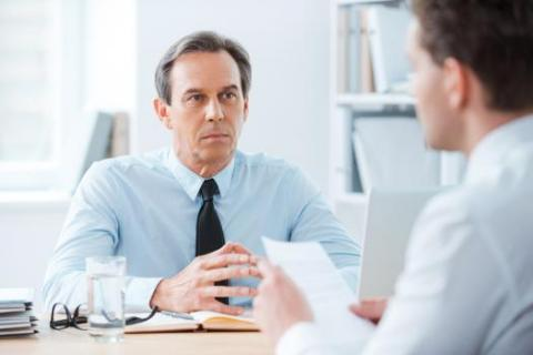 A job interviewer listens to prospective employee explain being fired