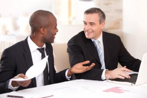 Managers with good communications skills engage in a discussion