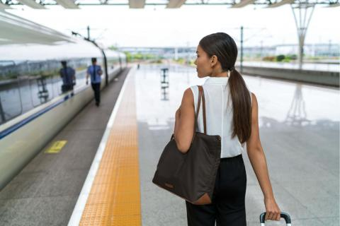 Woman at train station for business travel