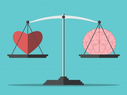 An illustration of a scale balancing a heart on one side and a brain on the other.