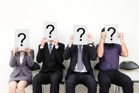 Job applicants holding question marks to ask in interview