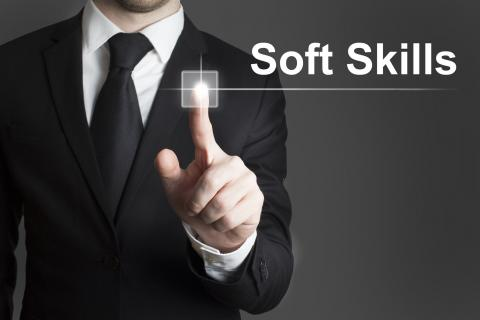 Man in suit with his finger on soft skills