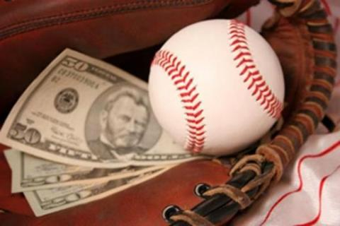 Cash and a baseball representing sports accounting jobs