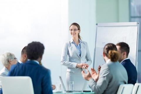 Woman using storytelling tips at meeting