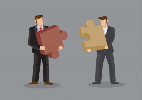 A illustration of two businessmen holding puzzle pieces that fit together