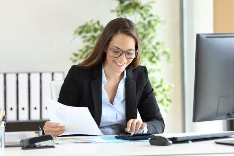 When and How to Hire a Bookkeeper Who is Right for Your Firm — Woman working at office desk