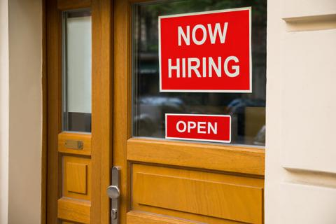 Now Hiring sign on door may not attract someone job hunting these days