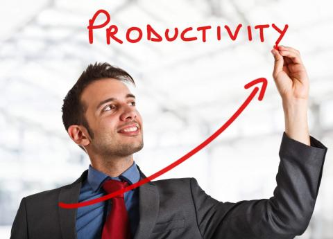 "15 Tips to Boost Productivity in the Workplace — man in suit writing word ""productivity"" in red"