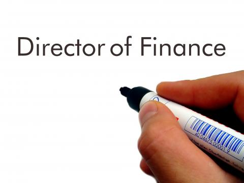 Pen at white board starting to write director of finance job description