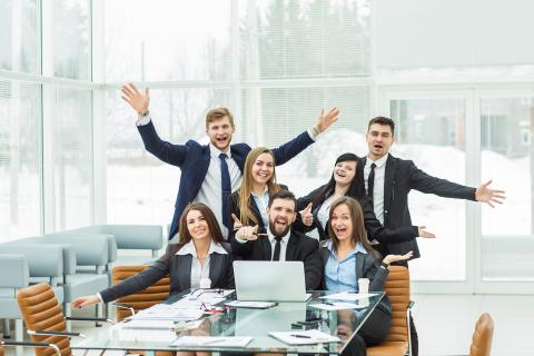 Group of people laughing, obviously enjoying fun accounting jobs