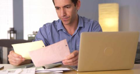 Business owner at laptop who wishes he was hiring accounting staff