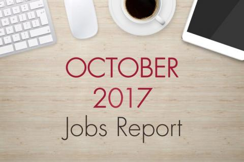 "An image of a desk with text that reads, ""October 2017 Jobs Report"""
