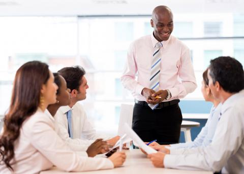 Image of business executive leading an informal team meeting