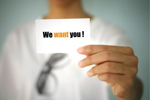 "Hand holding card, ""We want you!"" as a recruiting strategy for payroll staffing"