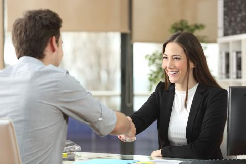 Man shaking the hand of a female job applicant.