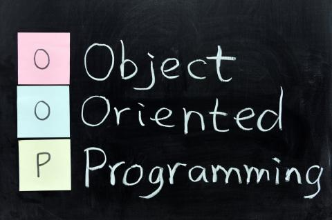 "The words ""object oriented programming"" written in white with black background."