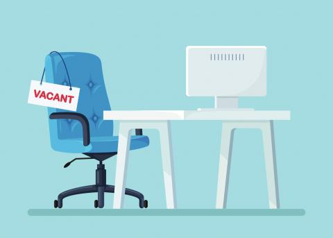 Illustration of an empty office chair with a vacant sign on it representing a hiring mistake.