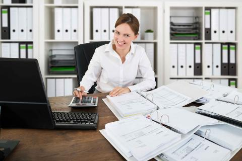 Woman working at desk where she knows how to answer: is accounting a good career choice