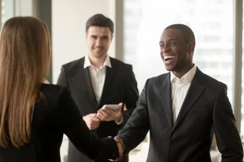Image of a new hire being greeted as part of an employee onboarding program.